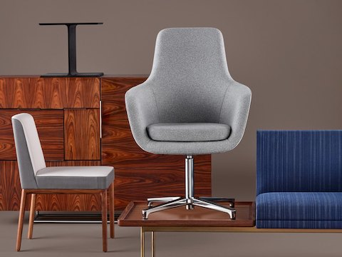An eclectic sampling of Geiger furniture, including the pedestal from an I Beam Table, a Domino Storage sideboard, and a Saiba Lounge Chair.