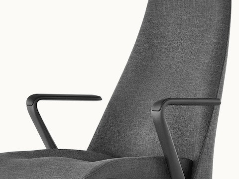 Partial angled view of a Taper office chair with black upholstery.