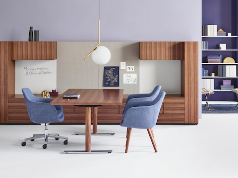 A private office featuring Geiger Rhythm Casegoods, a freestanding desk, and Saiba office and side chairs in matching light blue fabric.
