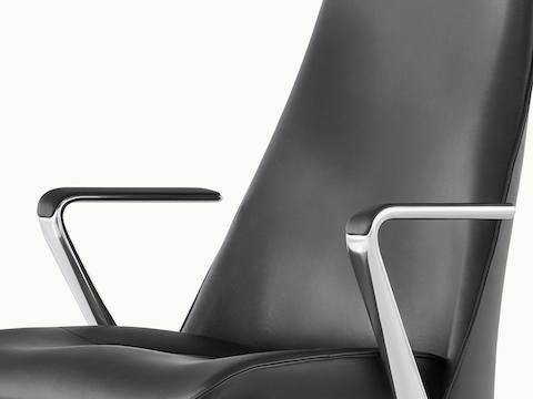 Angled view of a Taper office chair with black leather upholstery.