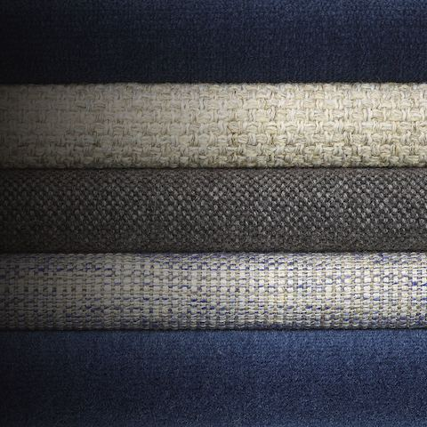A stack of five navy and light colored textiles from the Vivien Collection.