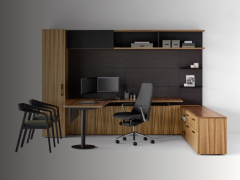 A private office featuring Geiger One Casegoods with a peninsula work surface and storage, a Taper office chair, and two Full Twist Guest Chairs.