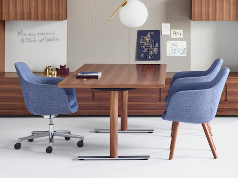 An executive office featuring a light blue Saiba office chair, two matching Saiba Side Chairs, and Geiger Rhythm Casegoods.