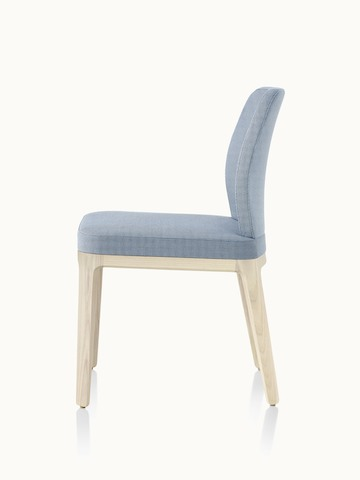 An armless A Line side chair with light gray upholstery, viewed from the side.