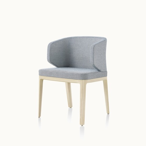 Angled view of a wingback A Line side chair with light gray upholstery. Select to go to the A Line Chair product page.