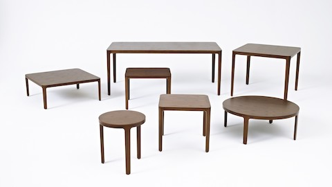 Seven A Line occasional tables of various shapes and sizes, all with veneer tops and solid wood legs.