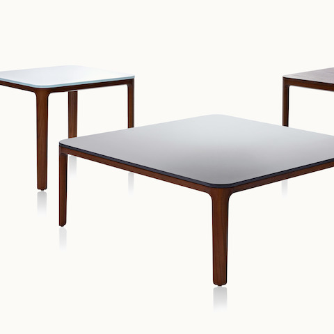 Partial view of three A Line occasional tables with glass or veneer tops. Select to go to the A Line Tables product page.