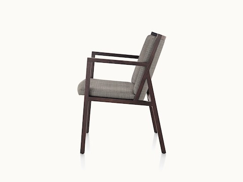 An Ascribe side chair with gray upholstery and a wood frame with a dark finish, viewed from the side.