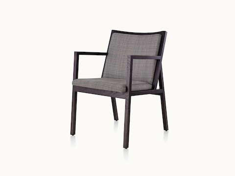 Angled view of an Ascribe side chair with gray upholstery and a wood frame with a dark finish.