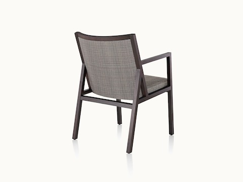 An Ascribe side chair with gray upholstery and a wood frame with a dark finish, viewed from behind at an angle.
