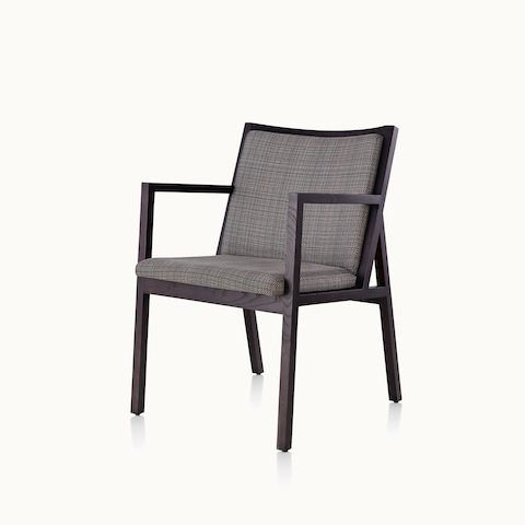 Angled view of an Ascribe side chair with gray upholstery and a wood frame. Select to go to the Ascribe Chair product page.