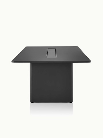 A rectangular Axon conference table in textured matte black, viewed from the side.