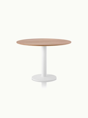 A round Axon Table with a natural oak veneer top and textured matte white base.