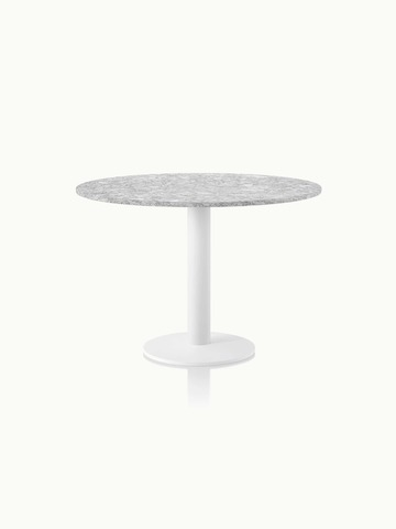 A round Axon Table with a gray Cambria Berwyn quartz top and textured matte white base.
