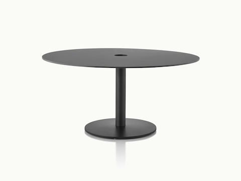 A round Axon Table with a black soft-touch laminate top and textured matte black base.