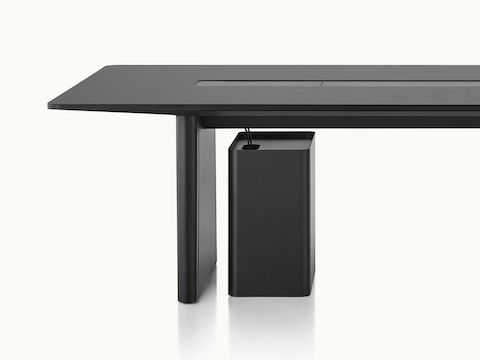 A mobile power and technology caddy beneath an Axon Table hides cables running from the floor to the tabletop.