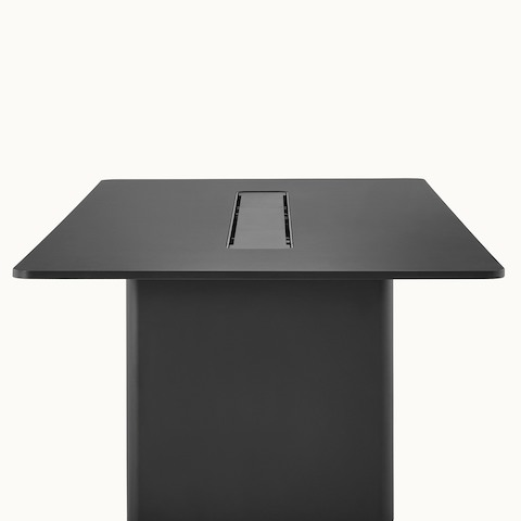 A black rectangular Axon conference table, viewed from the side, showing the fit and finish.