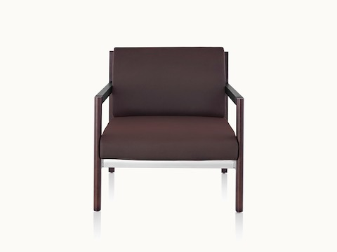 A Brabo club chair with dark brown upholstery, leather and metal accents, and an exposed wood frame, viewed from the front.
