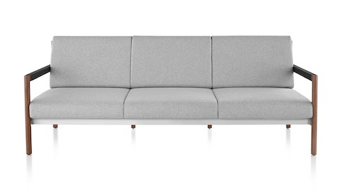 A Brabo Sofa with light gray upholstery, leather and metal accents, and an exposed wood frame. Viewed from the front.