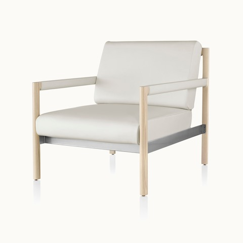 Angled view of a Brabo club chair with off-white leather upholstery, leather and metal accents, and an exposed wood frame.
