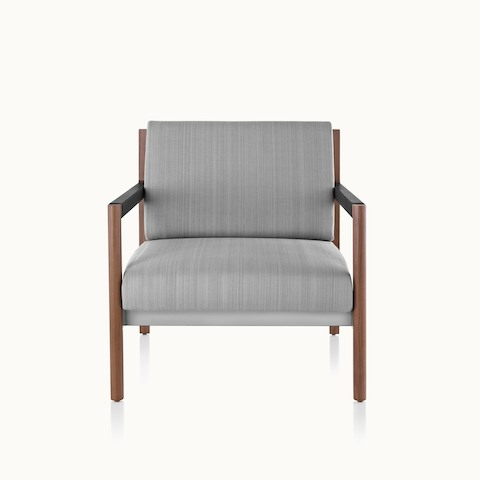 A Brabo club chair with light gray upholstery, leather and metal accents, and an exposed wood frame, viewed from the front.