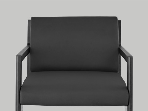 Black-and-white image of the seat and back of a Brabo club chair, viewed from the front.