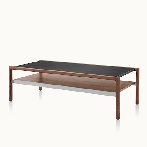 A Brabo coffee table with a black leather-wrapped top and walnut lower shelf, viewed at an angle. Select to go to the Brabo Tables product page.