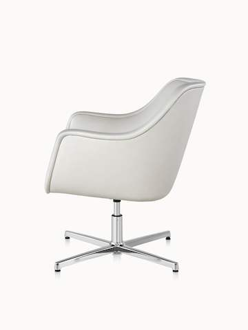 Side view of a Bumper lounge chair with off-white leather upholstery.