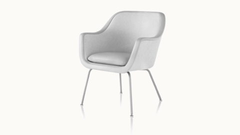 Angled view of a Bumper side chair with light gray fabric upholstery and a four-leg base.
