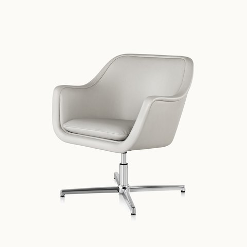 Angled view of a Bumper lounge chair with off-white leather upholstery. Select to go to the Bumper Chairs product page.