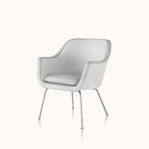 Angled view of a Bumper side chair with light gray fabric upholstery. Select to go to the Bumper Chairs product page.