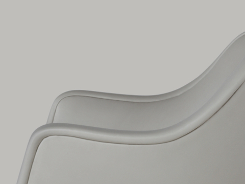 Partial side view of a Bumper Chair, focusing on the curved arms.