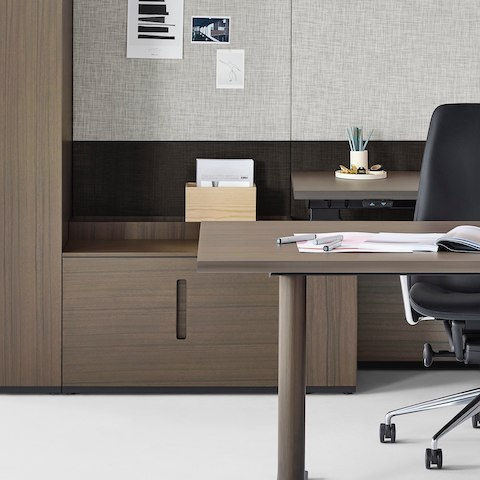 Partial view of a private office furnished with Geiger Rhythm Casegoods and a black leather Taper Chair. Select to go to the Private Office landing page.