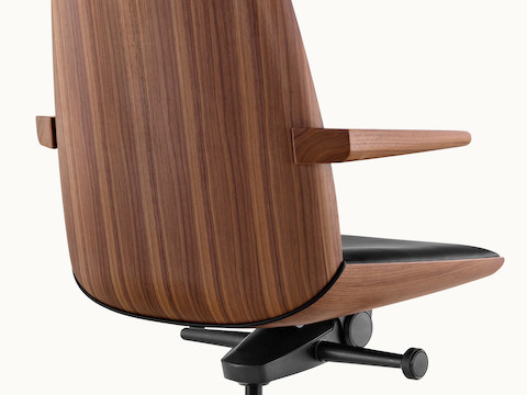 The veneer back of a Clamshell conference chair, viewed from behind at an angle. Select to go to the Conference Chairs landing page.