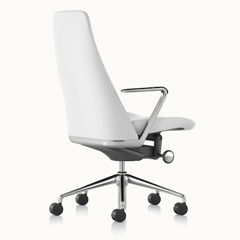 A Taper executive chair with white leather upholstery, viewed from behind at an angle. Select to go to the Office Chairs landing page.