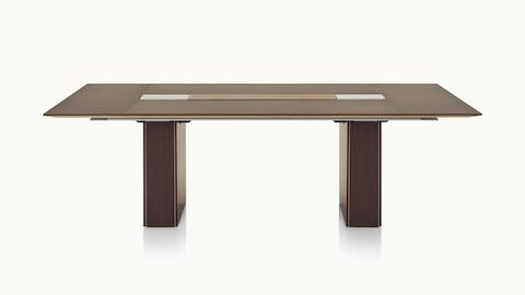A rectangular Caucus conference table a with a monolithic base and a dark recograin rosewood veneer finish, viewed from the front.