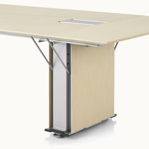 Partial angled view of a Caucus conference table with a plinth base.