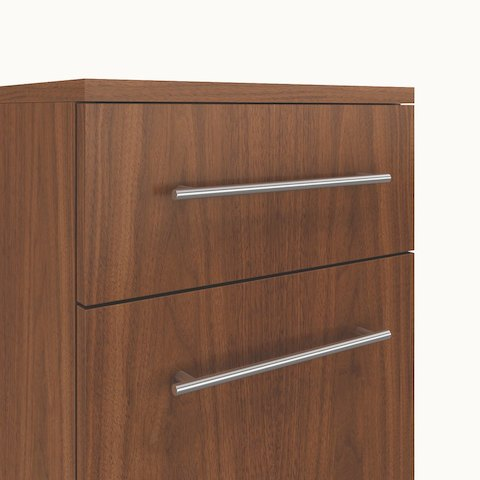 Close-up of two Barre pulls, a Caucus credenza option featuring a circular bar with rounded edges.