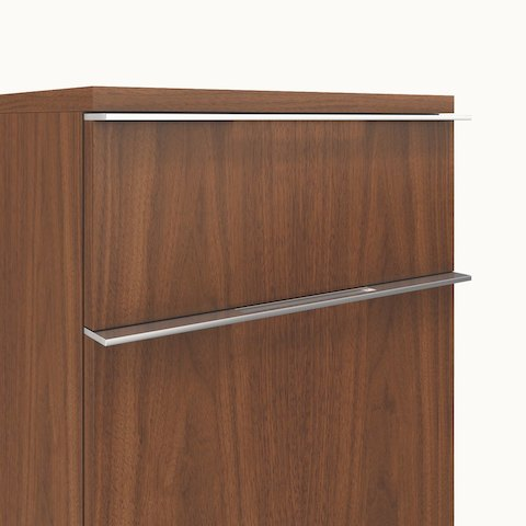 Close-up of two Caucus pulls, a Caucus credenza option consisting of a rectangular bar that spans the length of the drawer and has an inset in the middle.