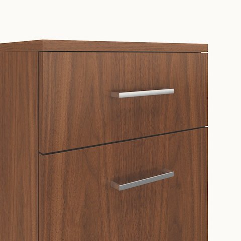 Close-up of two Frame pulls, a Caucus credenza option consisting of a rectangular bar with 90-degree angles.