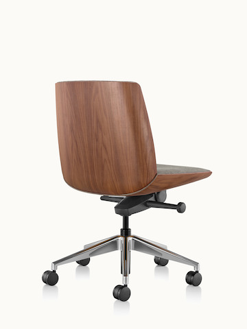 A low-back Clamshell office chair with a veneer shell in a light finish, viewed from behind at an angle.