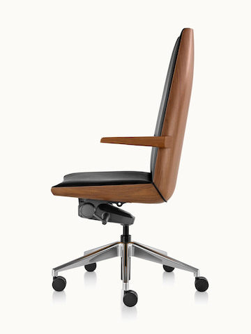 Side view of a high-back Clamshell office chair with arms, black leather upholstery, and a veneer shell in a medium finish.