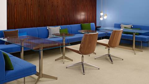 An informal interaction space featuring bright blue Tuxedo Component Lounge Seating and two Clamshell Side Chairs.