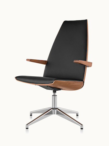 Angled view of a high-back Clamshell Lounge Chair with black leather upholstery and a four-star base.