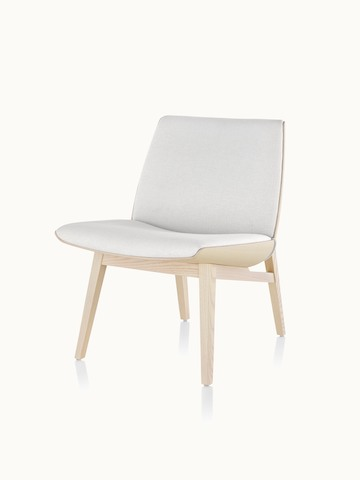 Angled view of a low-back Clamshell Lounge Chair with off-white fabric upholstery and four wood legs.