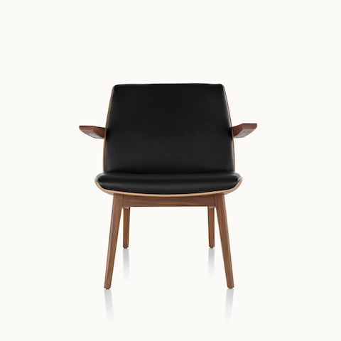 A low-back Clamshell Lounge Chair with black leather upholstery and four wood legs, viewed from the front.