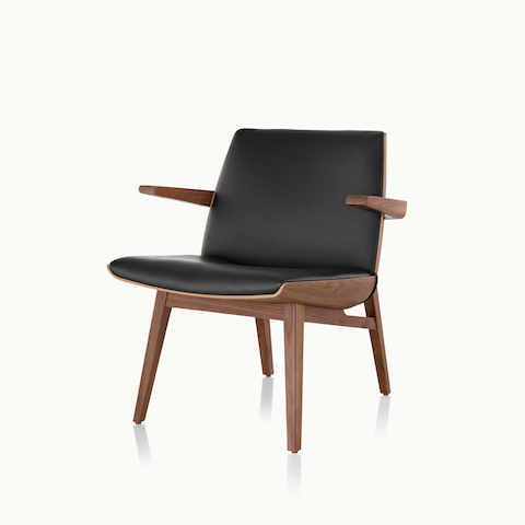 Angled view of a low-back Clamshell Lounge Chair with black leather upholstery. Select to go to the Clamshell Lounge Chair product page.