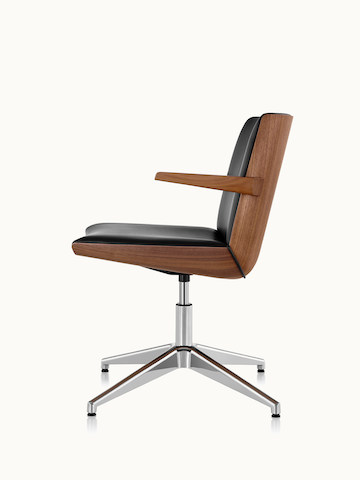 Side view of a Clamshell Side Chair with arms, black leather upholstery, and a veneer shell with a medium finish.