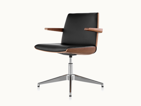 Angled view of a Clamshell Side Chair with black leather upholstery and arms.