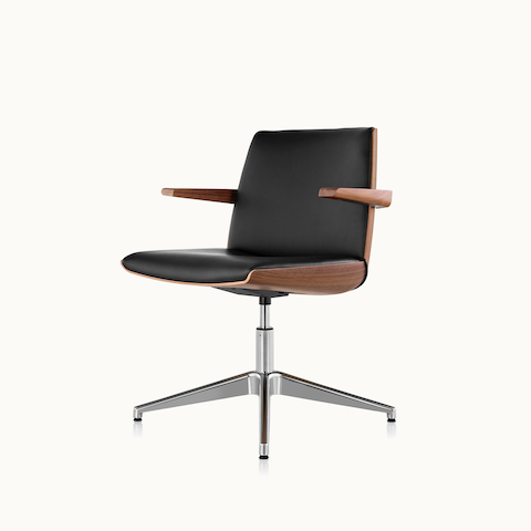 Angled view of a Clamshell Side Chair with black leather upholstery and arms. Select to go to the Clamshell Side Chair product page.